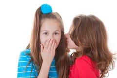 Kids whispering secrets. Gossip or scandal Royalty Free Stock Photo