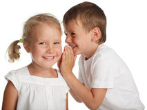 Kids whispers a secret. Boy whispers a secret to the girl Royalty Free Stock Image