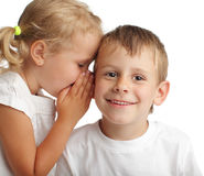 Kids whispers a secret stock photos