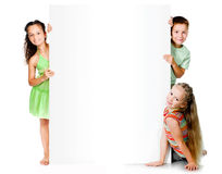 Kids with white banner Stock Photos
