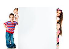 Kids beside a white blank Stock Photo