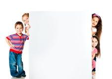 Kids beside a white blank stock photo