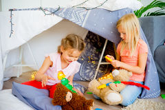 Kids in a wigwam Stock Images
