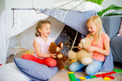 Kids in a wigwam Stock Image