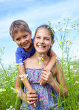 Kids with wild spring flowers Royalty Free Stock Image