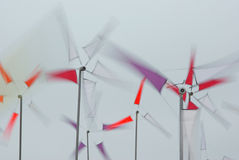 Kids windmills aligned. View of some kids windmills spinning in the wind Royalty Free Stock Photo