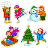 Kids in winter. Set of happy kids enjoying winter Stock Photos