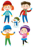 Kids in winter clothes and snowman Stock Photo