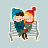 Kids winter 1. Cute valentine couple sitting on the bench Royalty Free Stock Photo