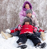Kids in winter park. Children in winter. Happy kids on snow Royalty Free Stock Photography