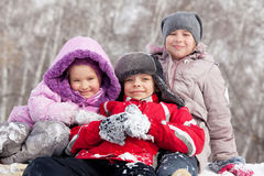 Kids in winter park Royalty Free Stock Images