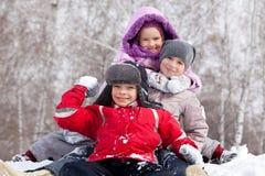 Kids in winter park Stock Photo