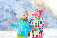 Kids winter snow ball fight. Children play in snow Royalty Free Stock Images