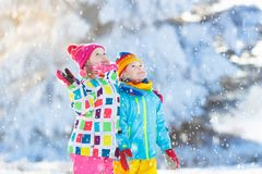 Kids winter snow ball fight. Children play in snow stock photos