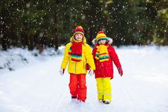 Kids winter snow ball fight. Children play in snow stock images