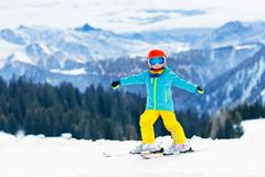 Kids winter snow sport. Children ski. Family skiing. Stock Photos