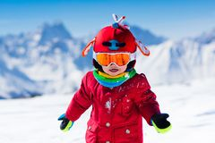 Kids winter snow sport. Children ski. Family skiing. Stock Photo