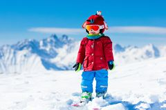 Kids winter snow sport. Children ski. Family skiing. Child skiing in the mountains. Kid in ski school. Winter sport for kids. Family Christmas vacation in the stock photo
