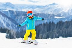 Kids winter snow sport. Children ski. Family skiing. Child skiing in the mountains. Kid in ski school. Winter sport for kids. Family Christmas vacation in the royalty free stock photos