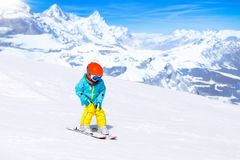 Kids winter snow sport. Children ski. Family skiing. Child skiing in the mountains. Kid in ski school. Winter sport for kids. Family Christmas vacation in the royalty free stock photo