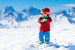 Kids winter snow sport. Children ski. Family skiing. Child skiing in the mountains. Kid in ski school. Winter sport for kids. Family Christmas vacation in the stock image