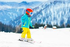 Kids winter snow sport. Children ski. Family skiing. Child skiing in the mountains. Kid in ski school. Winter sport for kids. Family Christmas vacation in the stock images