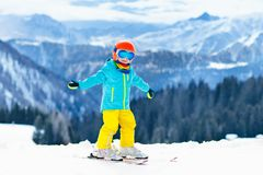 Kids winter snow sport. Children ski. Family skiing. Child skiing in the mountains. Kid in ski school. Winter sport for kids. Family Christmas vacation in the royalty free stock image