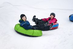 Kids Winter Snowtubing royalty free stock photo