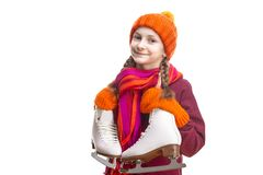 Kids Winter Sports.Portrait of Caucasian Girl in Winter Clothes Posing with Ice Skates Against Pure White Background stock image