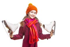 Kids Winter Sports.Portrait of Caucasian Girl in Winter Clothes Posing with Ice Skates In Both Hands Against Pure White Background royalty free stock image