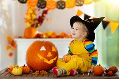 Kids in witch costume on Halloween trick or treat stock photos
