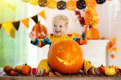 Kids in witch costume on Halloween trick or treat stock image