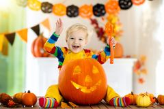 Kids in witch costume on Halloween trick or treat stock photo