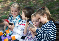 Kids With Mobile Devices Outdoor Royalty Free Stock Photos