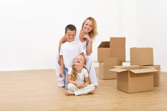 Kids and woman in their new big home Stock Images