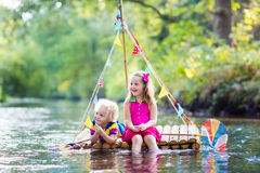Kids on wooden raft Royalty Free Stock Image