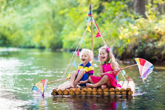 Kids on wooden raft Royalty Free Stock Photo