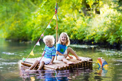 Kids on wooden raft Royalty Free Stock Image