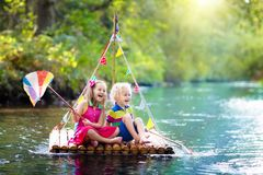 Kids on wooden raft Stock Images