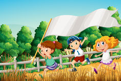 Kids at the woods with an empty banner Stock Image
