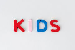 Kids. Word of wooden letters, text Stock Images