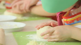 Kids work with dough. At the bakery class stock video