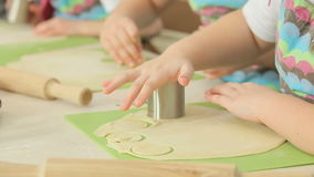 Kids work with dough. At the bakery class stock video footage