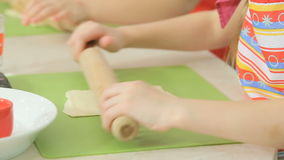 Kids work with dough stock footage