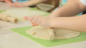 Kids work with dough stock video footage