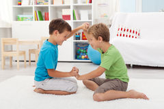 Kids wrestling on the floor Stock Images