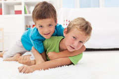 Kids wrestling on the floor - boys game Royalty Free Stock Images