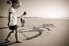 Kids writing in sand Royalty Free Stock Photography