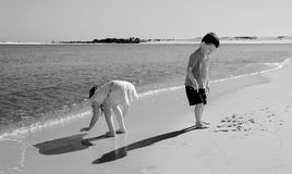 Kids Writing in Sand Royalty Free Stock Photo