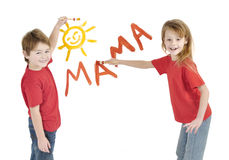 Kids writing word Mama royalty free stock images